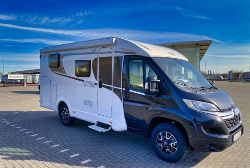 Hire a campervan in Lübeck from private owners  Carado V337 Flo