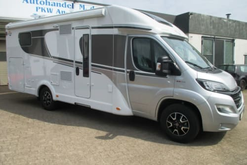 Hire a campervan in Ratekau from private owners  Carado Carado T447